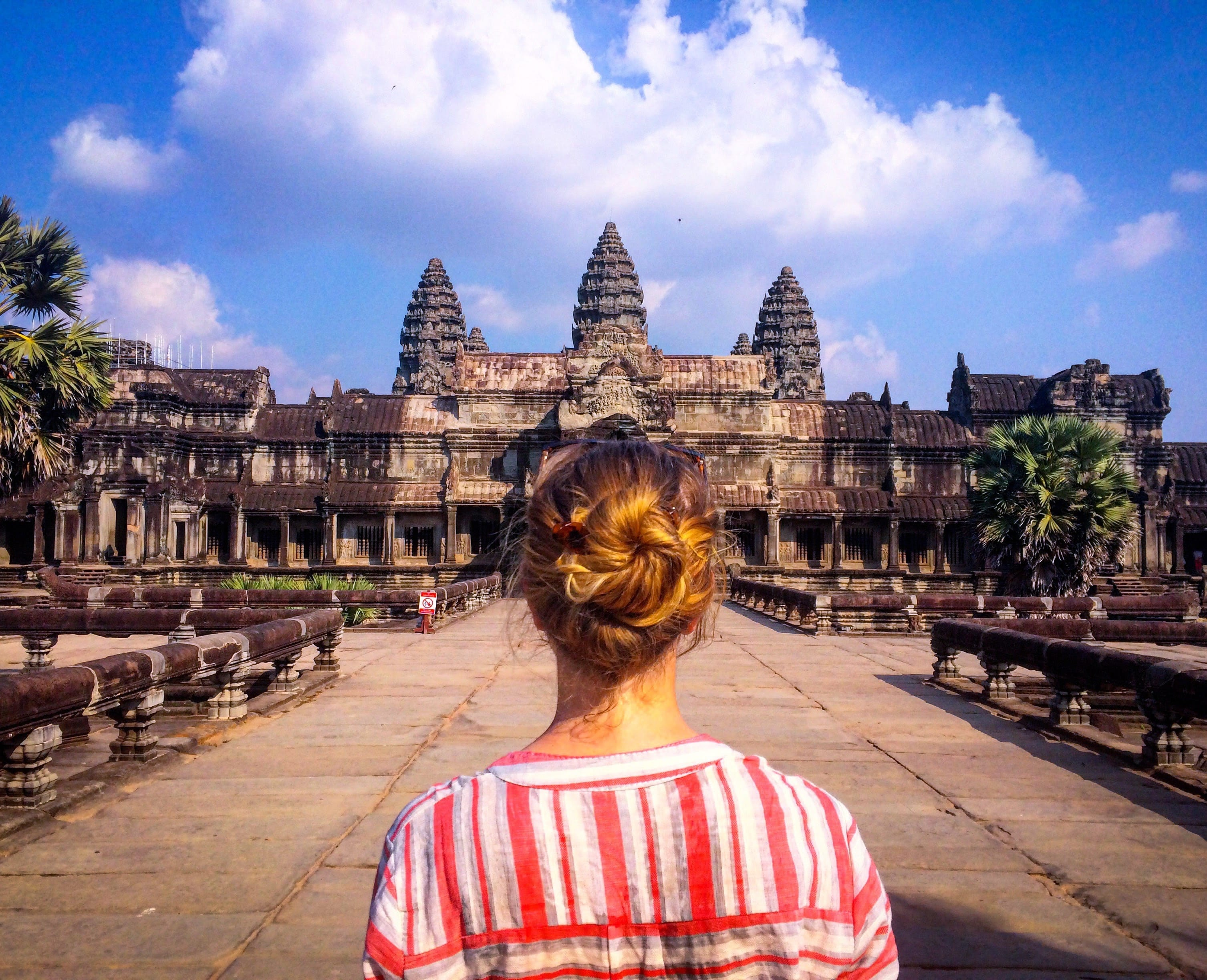 female traveler gazing at ancient building