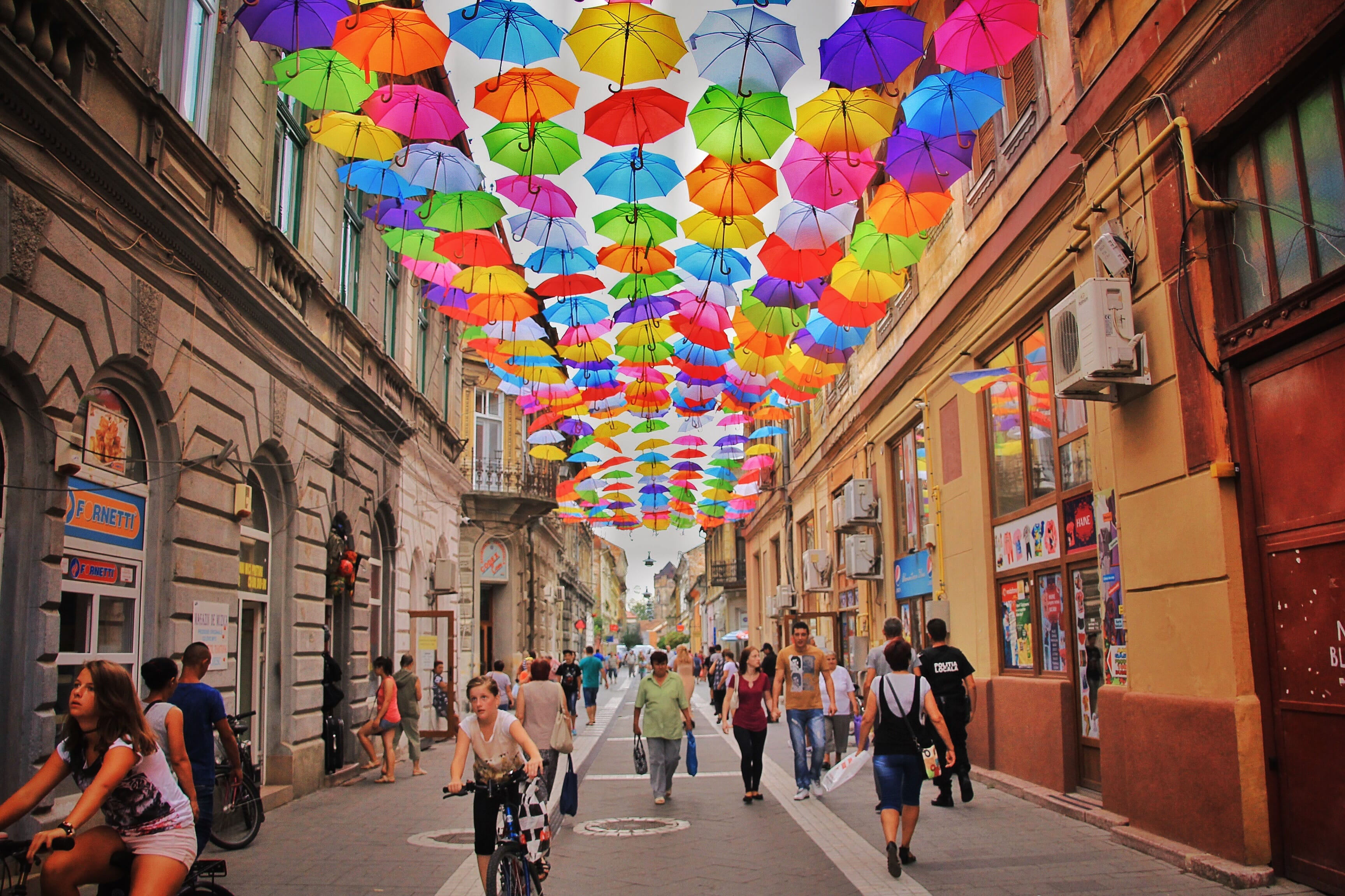 romania - colorful umbrellas above city street