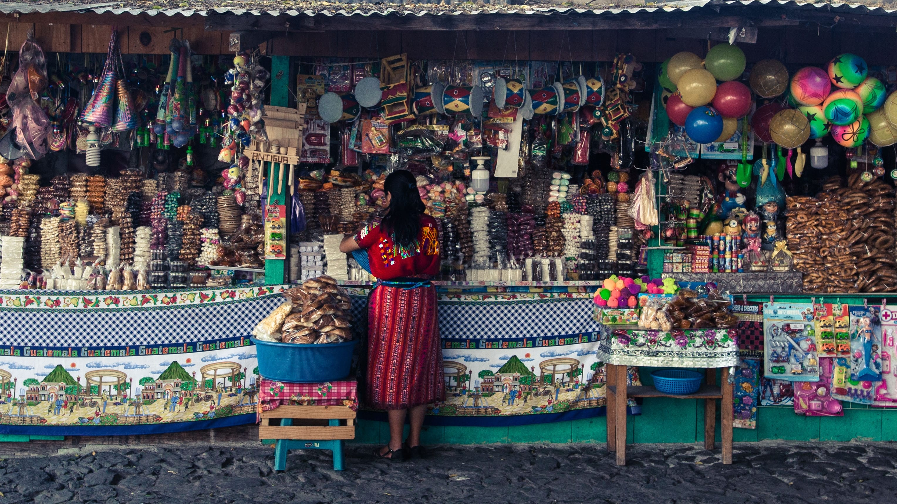 guatemala - woman shopping in local market